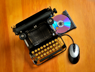typewriter with mouse and cd