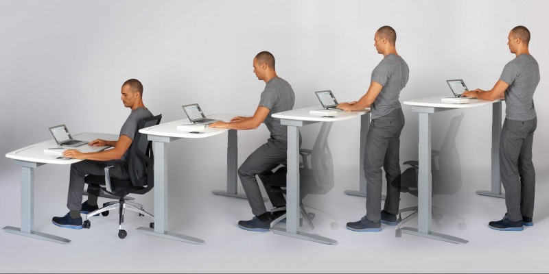 pros and cons of a standing desk Pros & Cons of Using a Standing Desk at Work pros and cons of a standing desk